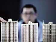 """在""""房住不炒""""的政策指引下,北京、深圳等多个热点城市的房价出现下调。"""